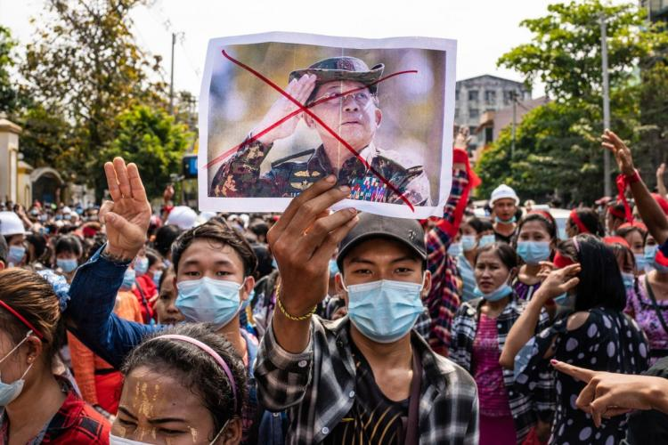 People holding placards at an earlier Protest against Military Coup in Myanmar