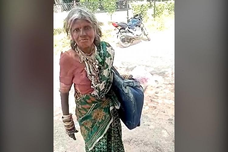 Destitute woman wearing a green saree She is carrying a black bag containing police files