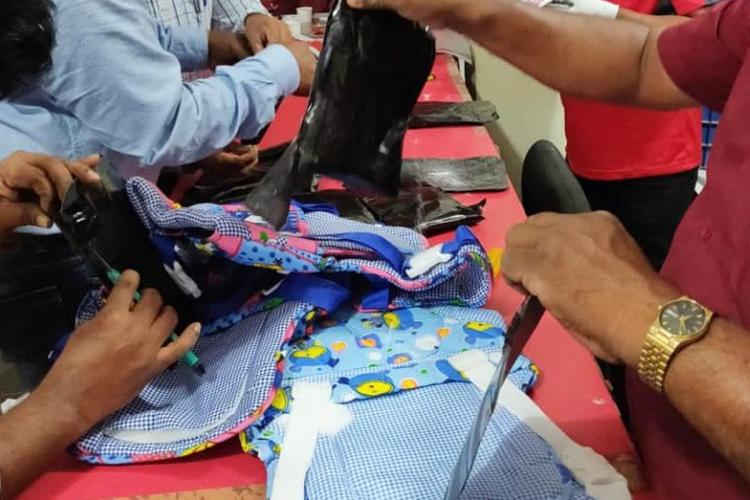 NCB officials uncovering pseudoephedrine concealed in baby bags