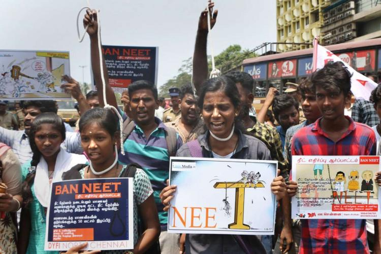 Members of Students' Federation of India (DYFI) stage a protest to seek scrapping of National Eligibility cum Entrance Test (NEET) in Tamil Nadu