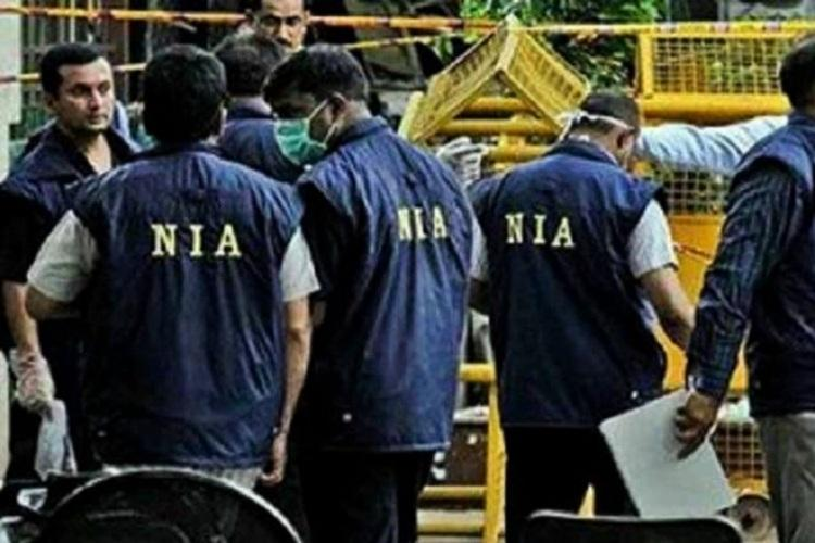 A representative image showing the uniforms of officials of the National Investigation Agency which have the letters NIA inscribed in yellow on the back