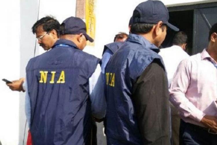 NIA officials during a raid