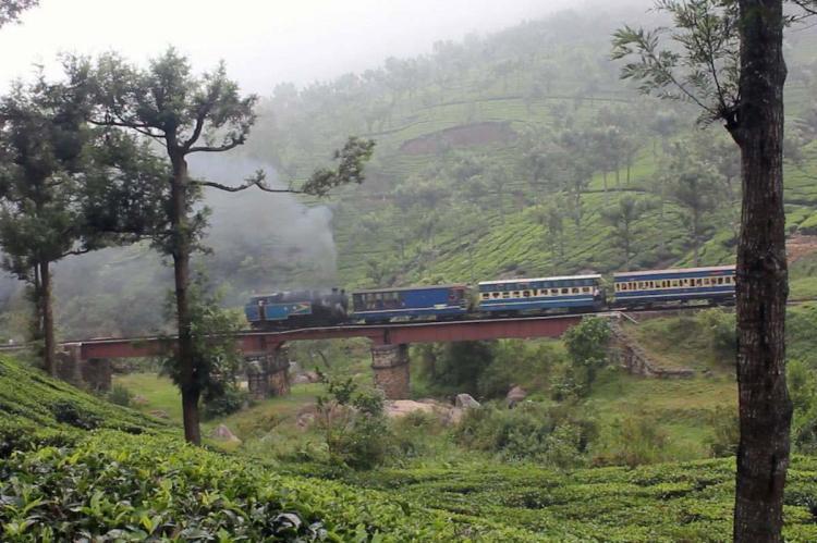 Nilgiris Mountain Railway train chugging on a bridge in Ooty