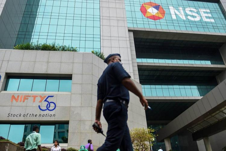 NSE headquarters with logo visible security guard walking across