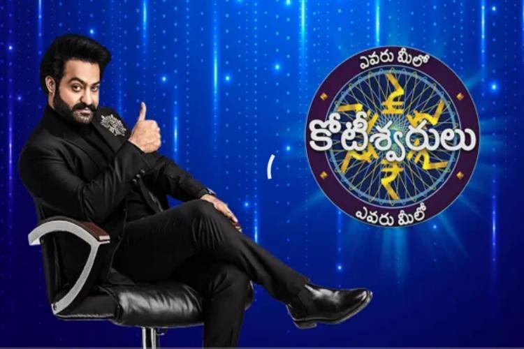 Jr NTR is seen in a black suit in the promo of 'Evaru Meelo Koteeswarulu'.