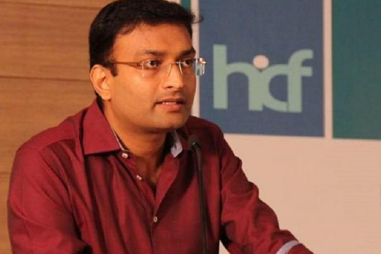 N Prasanth IAS. Clad in a maroon shirt, he is talking at an event