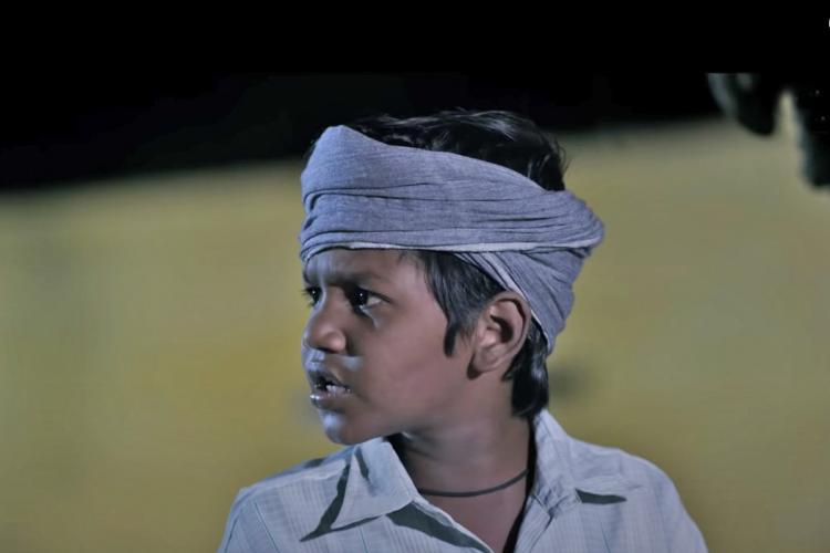Naga Vishal as Kutty in the movie 'KD Engira Karuppudurai'.