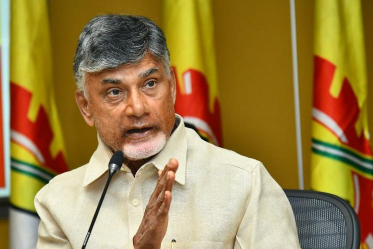 TDP chief Chandrababu Naidu speaking into a mic