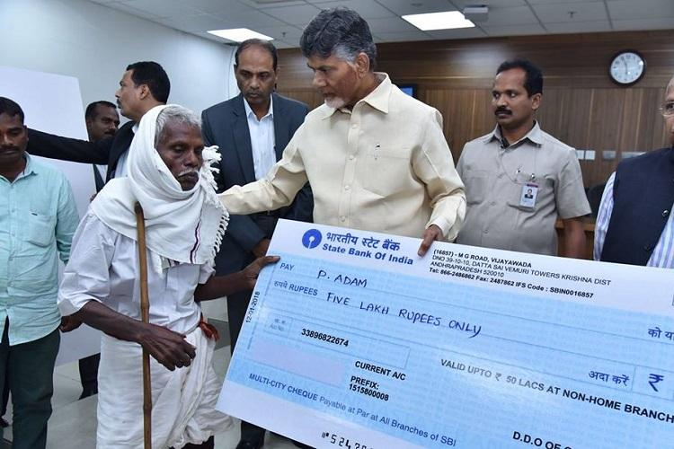 AgriGold scam Andhra CM Naidu distributes Rs 5-crore relief to family of victims
