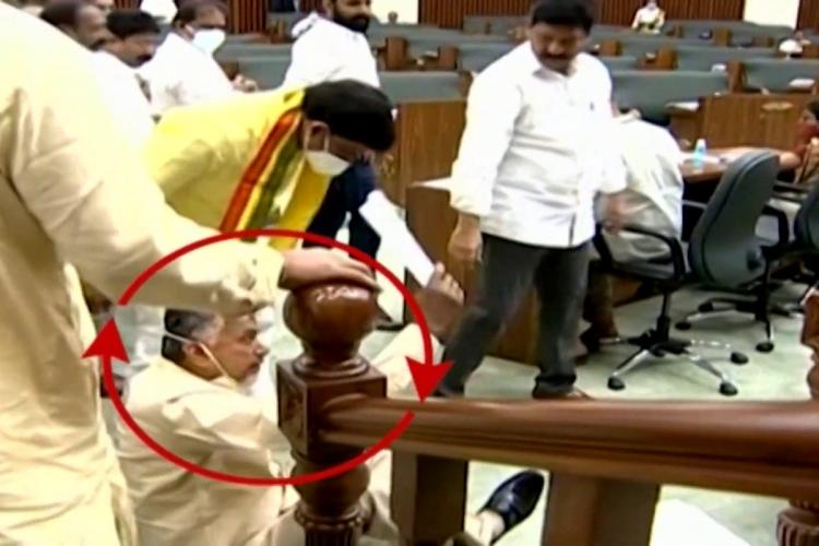 Chandrababu Naidu sitting on the floor near the Speakers podium a red circle has been drawn around his face