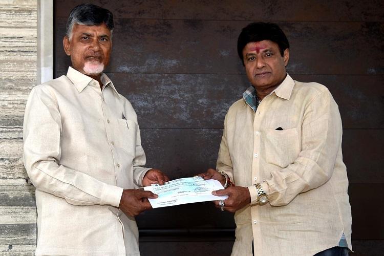 Balakrishna meets Andhra CM Naidu donates Rs 25 lakh for Cyclone Titli relief
