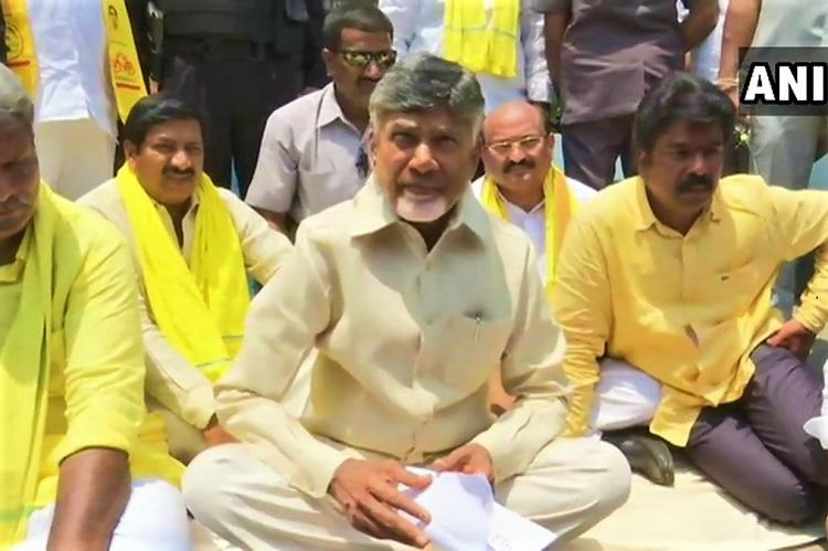 Police raids on TDP MP Andhra CM Naidu sits in front of Ambedkar statue to protest