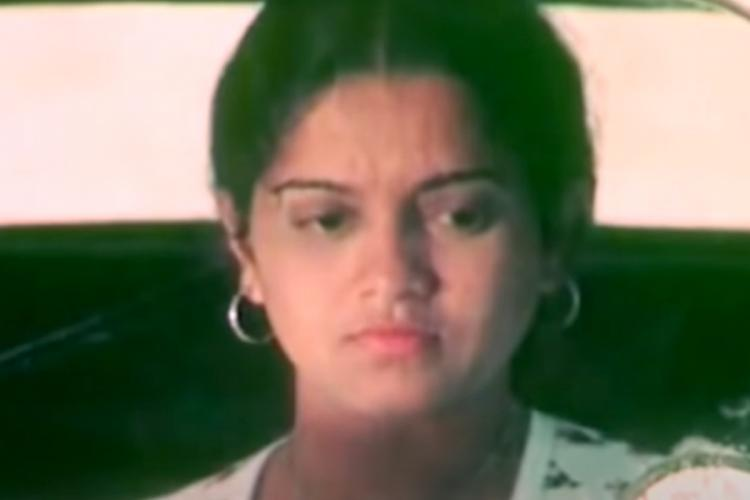 Scene from the Kannada film Nalegalanna Maduvavaru showing a close-up of the female lead Rekha Rao
