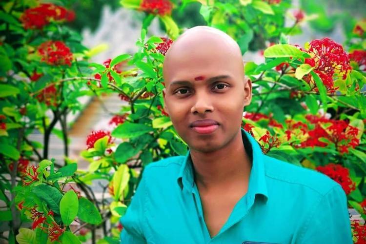 Cancer survivor Nandu Mahadeva in blue shirt