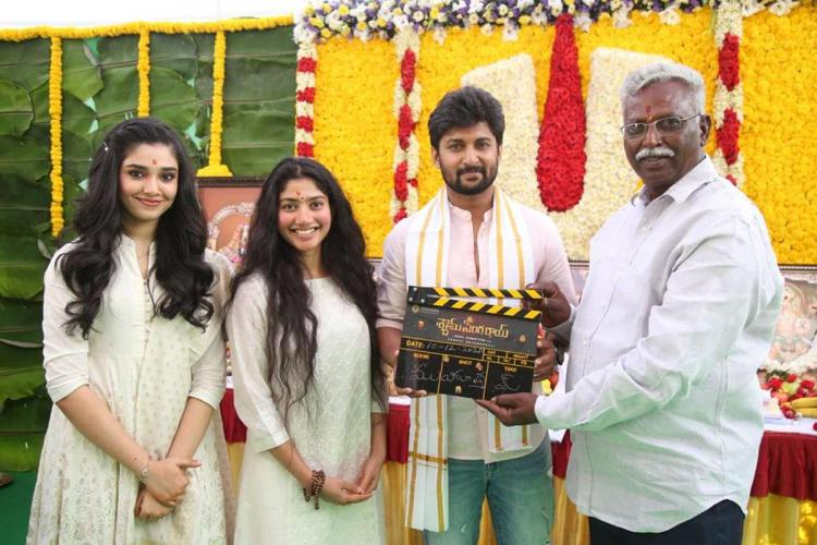 Tollywood actor Nani Sai Pallavi seen in a clap board ceremony for a telugu film all are posing for a picture wearing white