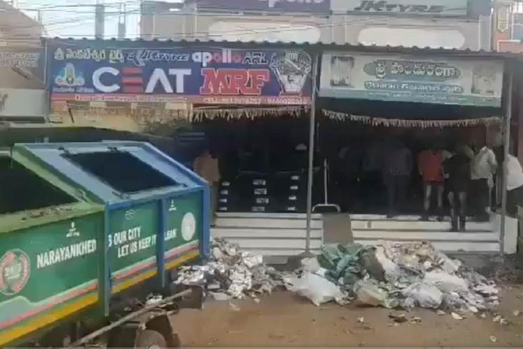 Narayakhed municipality truck dumps garbage before tax defaulters shop