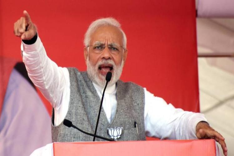Will Telanganas future be decided by people or astrologer Modi hits out at KCR