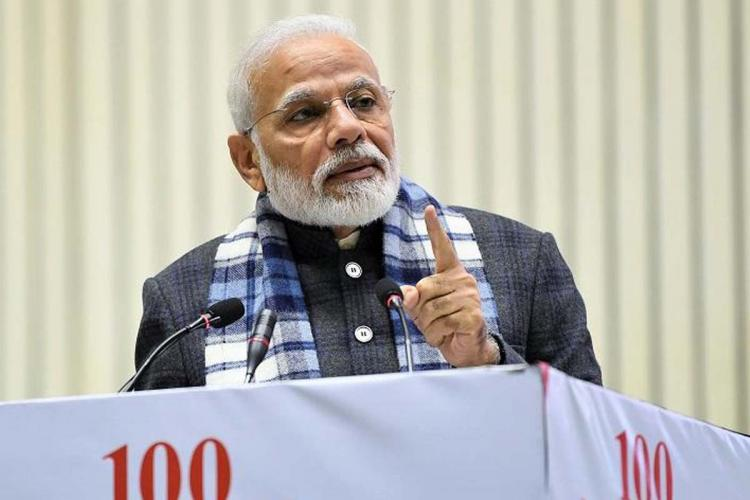Indian PM Narendra Modi addressing an audience He is looking forwards to the right