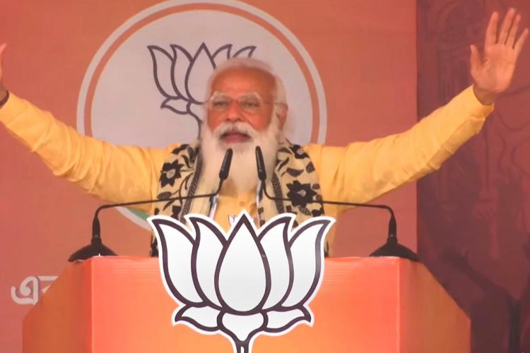Narendra Modi speaks without a mask at an election rally in West Bengal