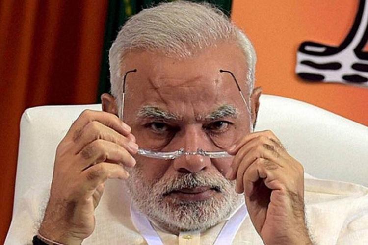 Narendra Modi checking his spectacles