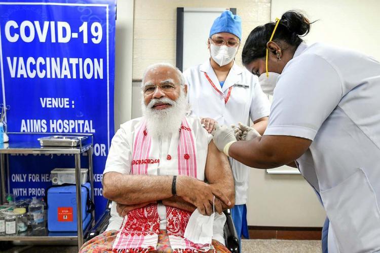 Prime Minister Narendra Modi getting vaccinated against COVID-19 at AIIMS Delhi.