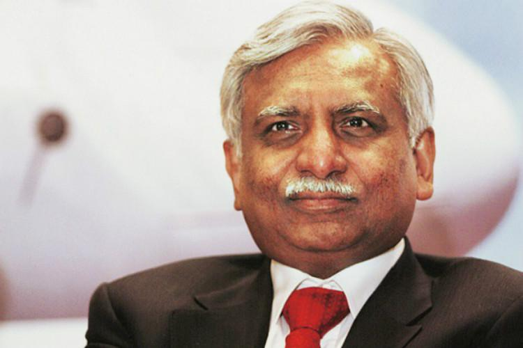 Jet Airways chairman Naresh Goyal steps down, halves stake