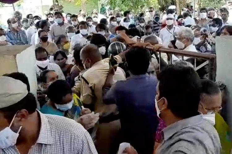 People trying to storm into vaccination center in Narasaraopet of Guntur in Andhra