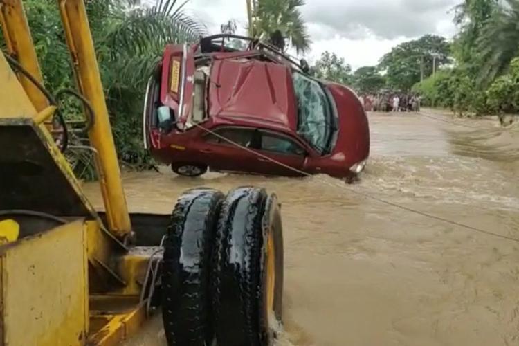 Car sweeps away in Narsipatnam Andhra Pradesh
