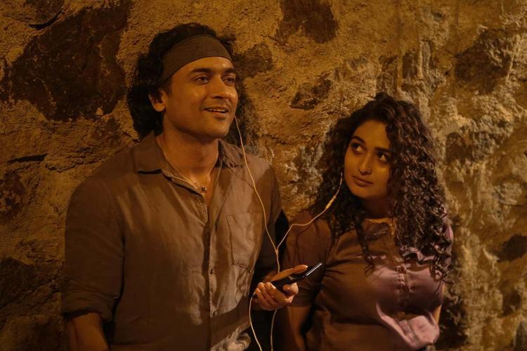 Suriya and Pragya Martin are seen listening to music together in a still from Navarasa