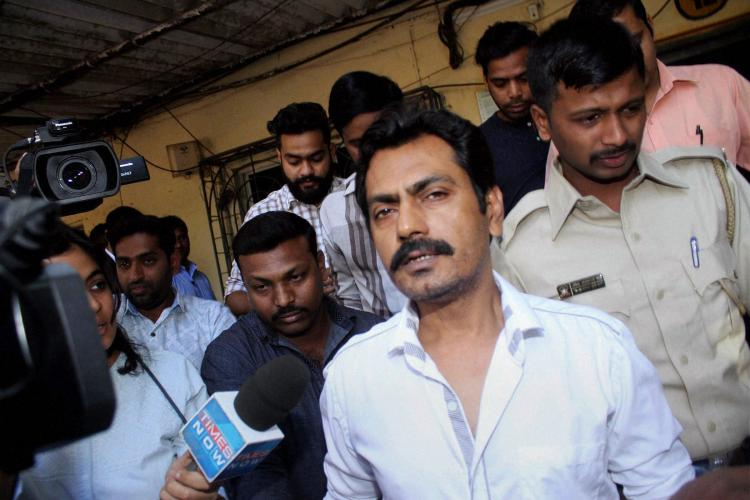 Actor Nawazuddin Siddiquis wife lodges counter FIR against 5 residents in parking row