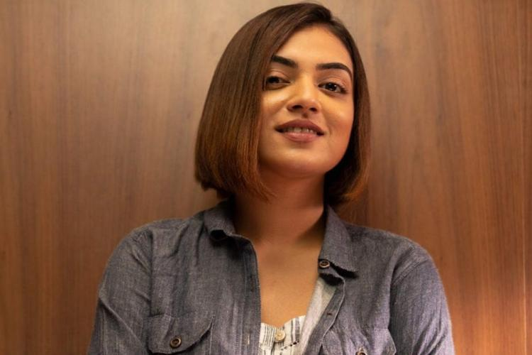 Nazriya is seen wearing a jacket in a new hairdo in the image