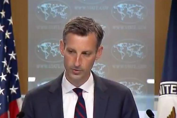 State Department spokesperson Ned Price in a navy blue suit and tie