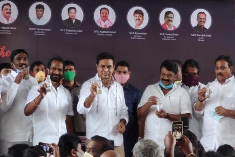 Telangana Ministers KTR and Srinivas Goud with a few other leaders drinking Neera at the inaugural event of laying foundation Telanganas first Neeracafe