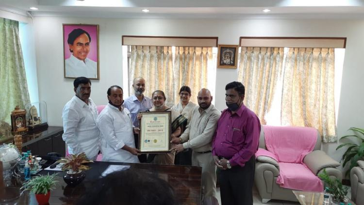 Nehru Zoo park officials receiving certification from the ISO officials in a closed room
