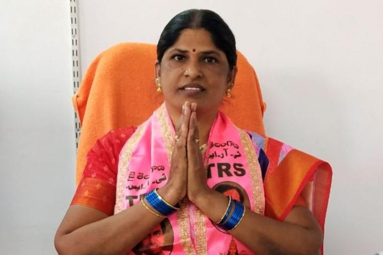 TRS candidate Meena folding her hands appealing the voters to vote for her