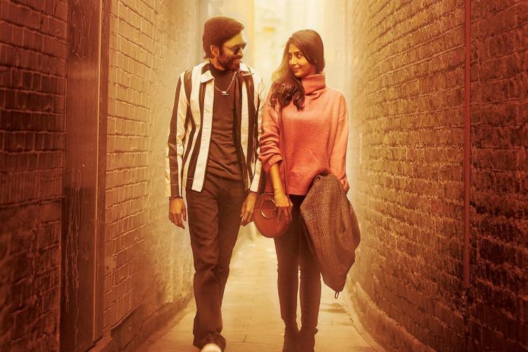 Dhanush and Aishwarya Lekshmi are seen taking a stroll in a narrow street in the image