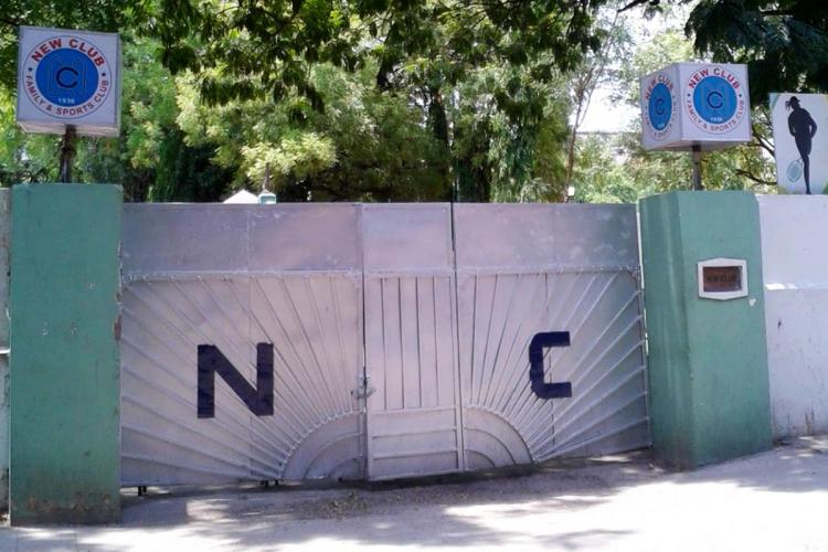 The entrance to New Club in Secunderabad featuring a grey-painted gate