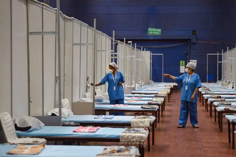 A representative image of a coronavirus treatment ward with nurses in PPE