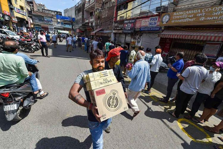 A person buys liquor amid the coronavirus lockdown in India