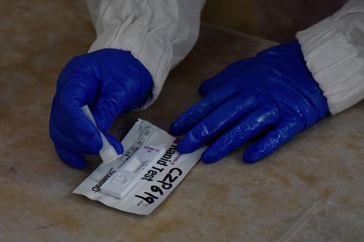 Health worker taking antigen test
