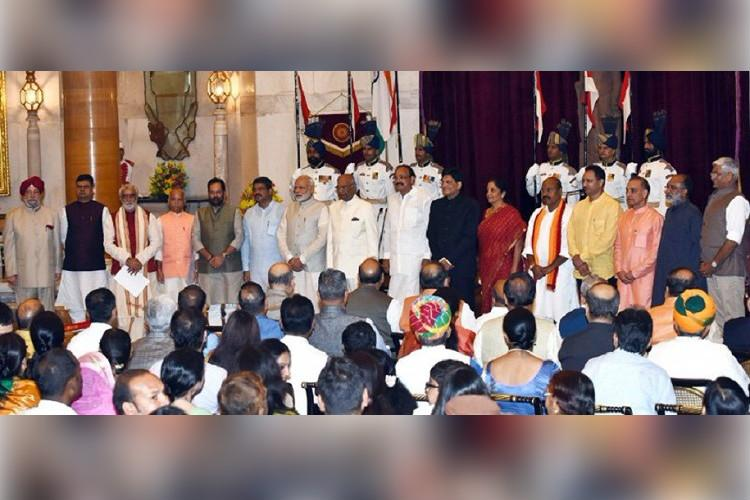 Pm Modi Promotes Four Mos To Cabinet Inducts Nine New