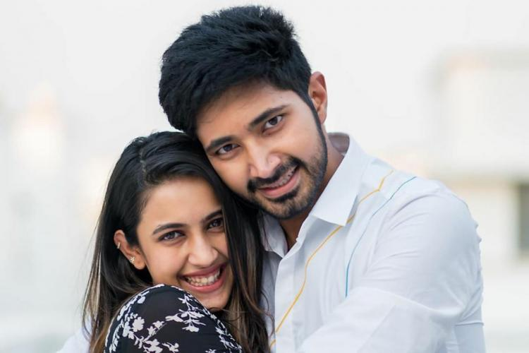 Niharika and Fiance Chaitanya posing for a picture Niharika was seen wearing black and white dress while chaitanya was wearing white shirt