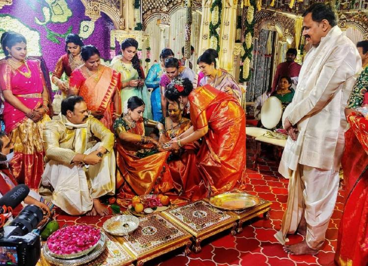 Niharikas family along with her parents and relatives in the marriage ceremony wearing pattu clothes