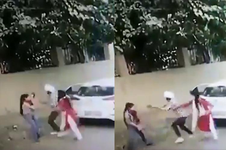 A grab from CCTV footage that shows a man believed to be Taufeq brandishing a gun at a woman identified as Nikita Tomar in Ballabhgarh