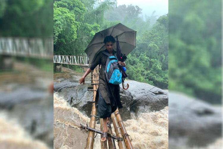 A teacher crossing river to reach tribal hamlets in Kerala to make virtual learning resources to tribal students