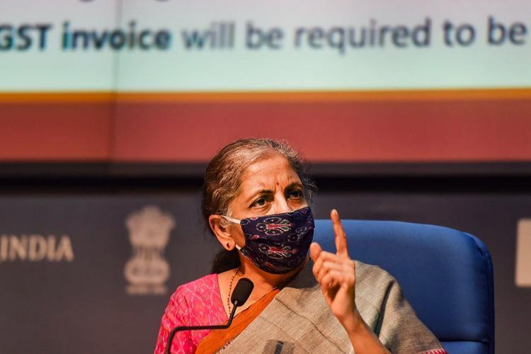 Nirmala Sitharaman at a press conference, wearing mask