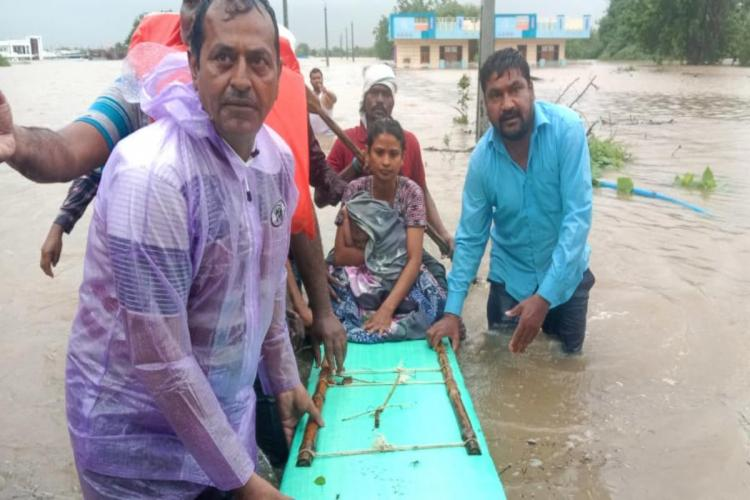 A new born mother being rescued by the rescue team in Nirmal town