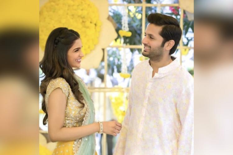 Actor Nithiin standing beside his girlfriend Shalini