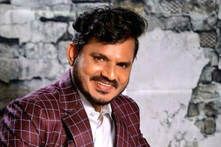 Nithish Veera in a brown suit