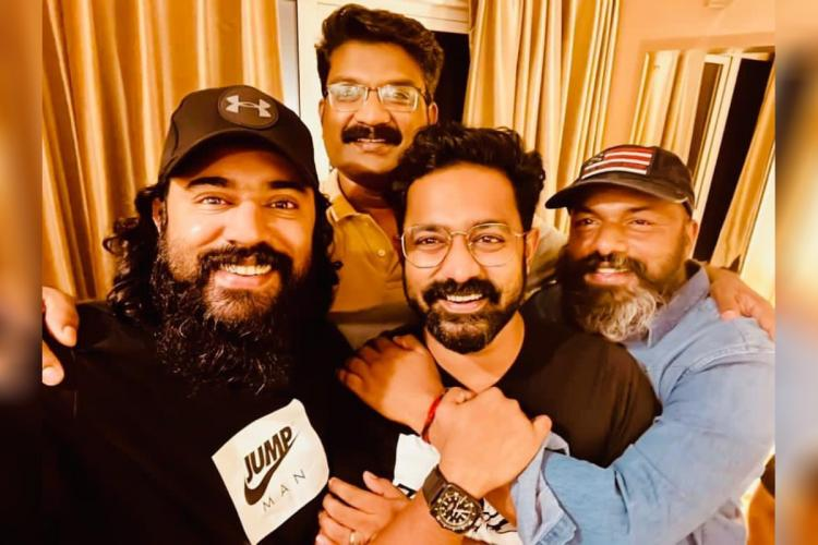 Nivin Pauly is seen along with some of the cast and crew members of Mahaveeryar